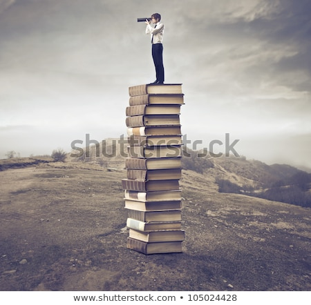 young boy with stack of books stock photo © get4net