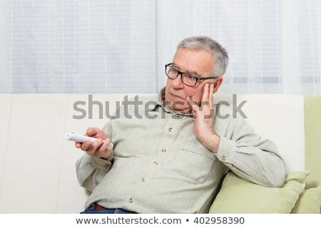 There is nothing interesting on tv. Stock photo © d13