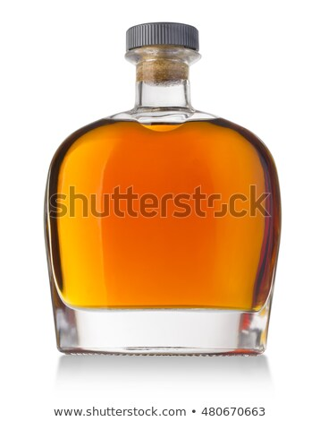 Glass of cognac with bottle on white Stock photo © Escander81