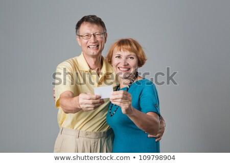 Oude man tonen Rood kaart Stockfoto © Saphira