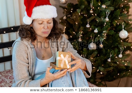 Unhappy, grumpy christmas woman Stock photo © ichiosea