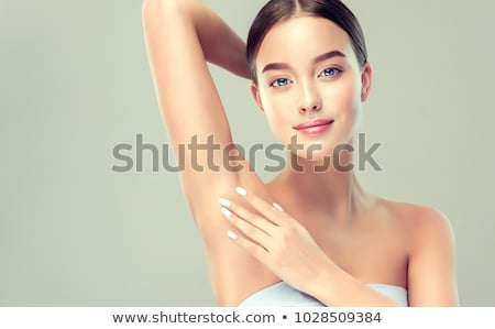Portrait of young female shaving her armpit Stock photo © HASLOO