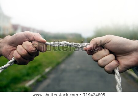 rope fight fight of two hands pulling rope to each other stock photo © inxti