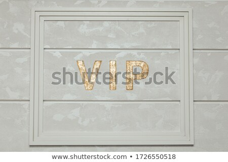 Golden VIP abbreviation isolated on white with color background  Stock photo © tuulijumala