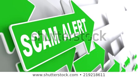 scam alert on green direction arrow sign stock photo © tashatuvango