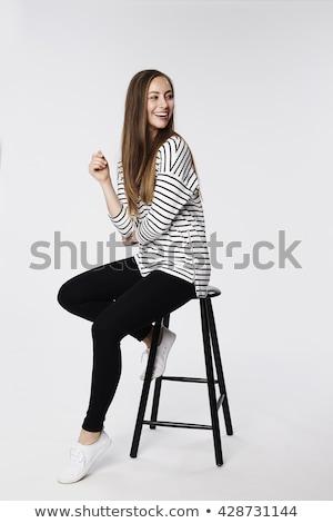 Fiatal lezser nő ül zsámoly oldalnézet Stock fotó © feedough