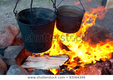 sooty pot tourist hanging over the fire stock photo © oei1