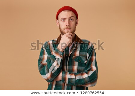 Man with beard in checkered shirt holding camera  Stock photo © Nejron