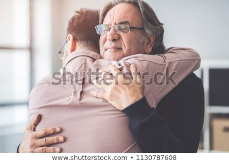 father hugging his happy smiling son Stock photo © meinzahn