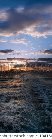 Panoramic sunset over boat motor ripples on the water Stock photo © slunicko