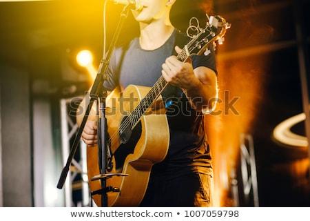 Masculina manos jugando guitarra acústica primer plano mano Foto stock © Valeriy