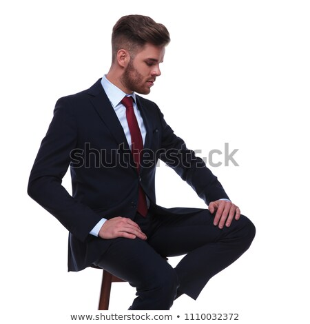 business man looking down while resting on a stool stock photo © feedough