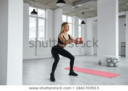 jovem · treinamento · halteres · isolado · branco - foto stock © acidgrey