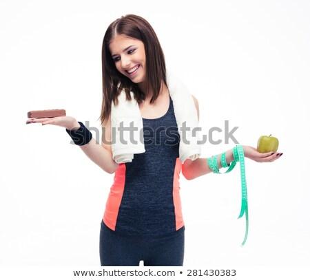 Sports woman making choice between bananas and chocolate Stock photo © deandrobot