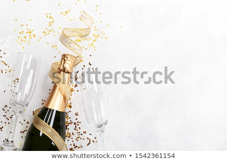 Two glasses of Christmas champagne stock photo © neirfy