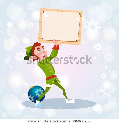 Stock photo: Santa's Elf Holding a Blank Sign