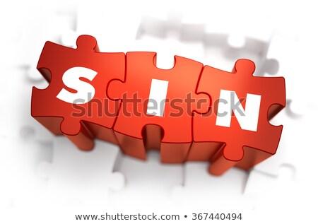 sin   text on red puzzles stock photo © tashatuvango