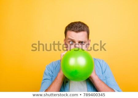 Funny guy grimacing over green background Stock photo © konradbak