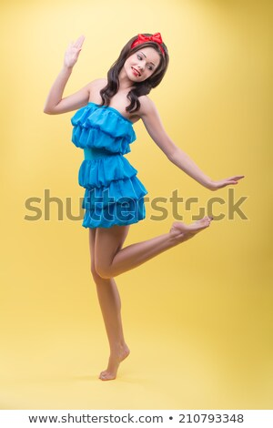 full length portrait of a charming woman with candy stock photo © deandrobot