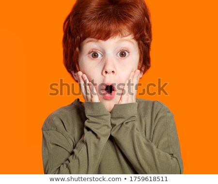 Red Headed very cute girl thinking seriously Stock photo © Giulio_Fornasar