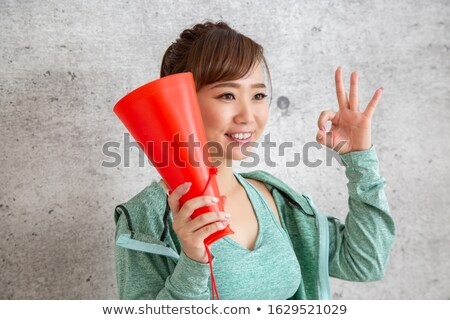 Fitness instructor says into a megaphone. Stock photo © studioworkstock