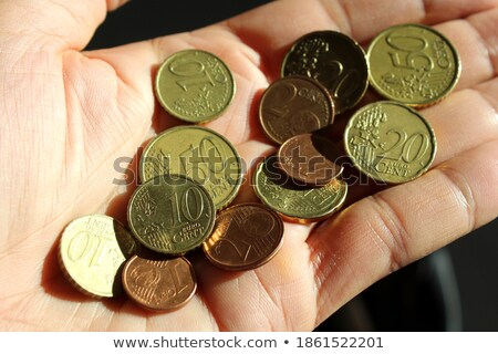 man offering one euro coin on hand palm stock photo © stevanovicigor