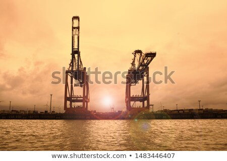 Foto stock: Industrial Harbor Crane At Sunset
