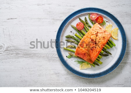 Salmón vegetales adornar placa limón Foto stock © Digifoodstock