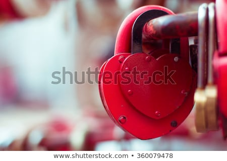 Vintage closed red padlock in heart shape Close Up on a blurred  Stock photo © Yatsenko
