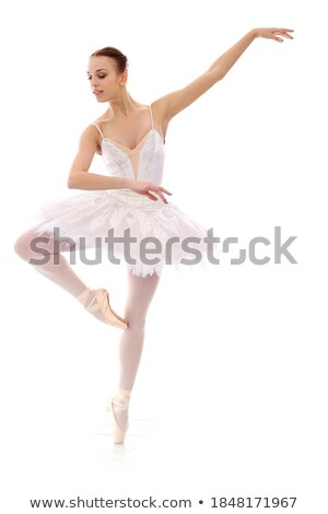 Ballerina in white dress posing on toes, studio background. Stock photo © master1305