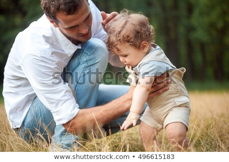 young beautiful father mother and little toddler son against green trees stock photo © master1305