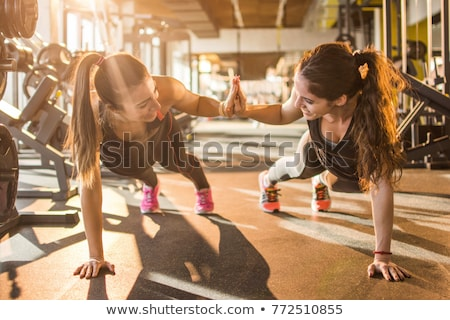 Happy trainer and girl giving high five to each other Stock photo © wavebreak_media
