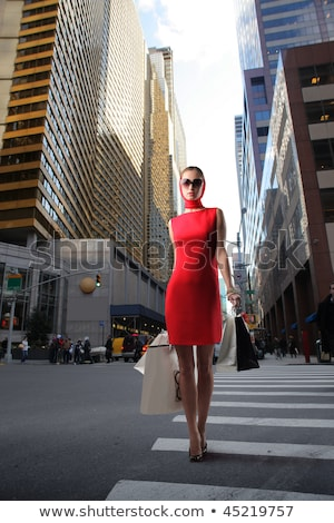 happy woman in red dress driving car stock photo © vlad_star