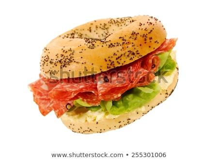 Bagel szendvics szalámi fehér tányér étel Stock fotó © Digifoodstock