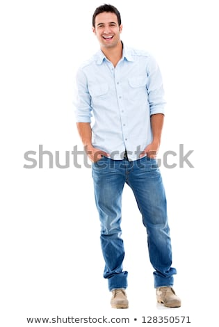 Happy young man standing isolated over white background Stock photo © deandrobot