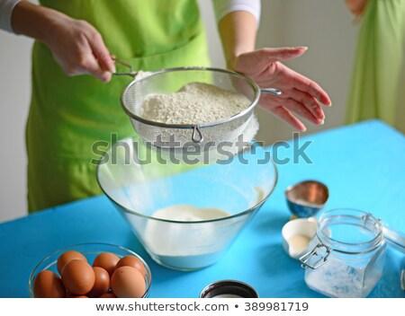 Woman sieving flour into the bowl Stock photo © wavebreak_media