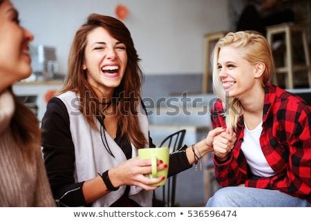 Fiatal nők tea kávézó belső szín együtt Stock fotó © monkey_business