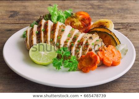 Grillcsirke mell felszolgált tányér citrom fából készült Stock fotó © Virgin