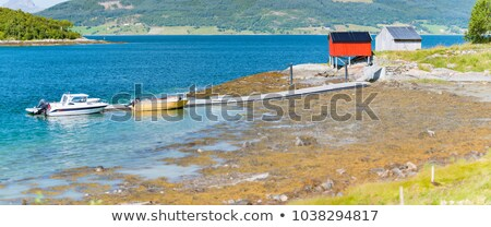 Barn in Norway, Europe. Mountains, river and boat. Stock photo © kyolshin