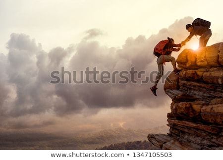 Stock photo: Teamwork couple climbing with helping hand