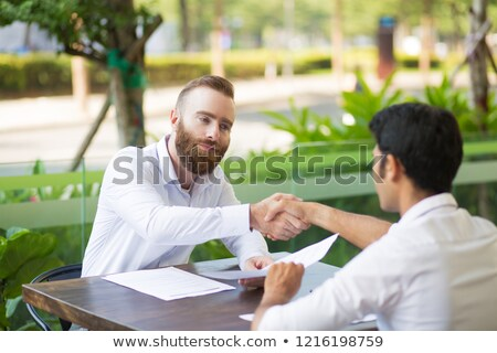 Indian bearded businessmen conclude a contract Stock photo © studioworkstock