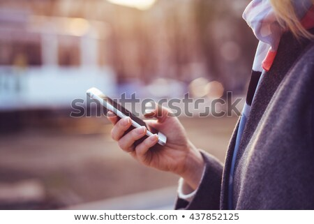 close up of female hands using smartphone outdoors stock photo © stevanovicigor