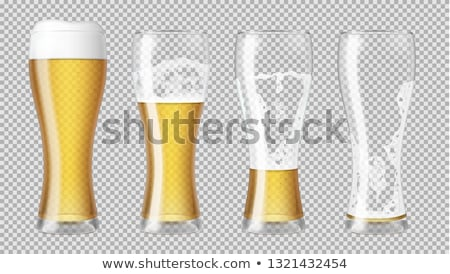 Tall beer glass almost full with lager beer Stock photo © pakete