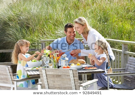 Father pouring wine at family lunch Stock photo © IS2