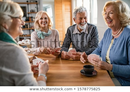Woman having Coffee while playing cards Stock photo © IS2