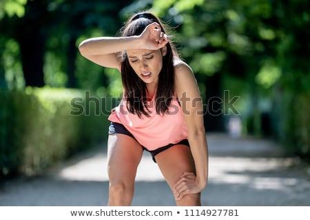 portrait of woman taking break from jogging stock photo © boggy