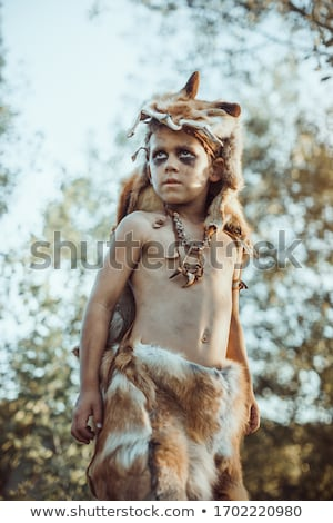 Caveman, manly boy hunting outdoors. Ancient warrior portrait. Stock photo © artfotodima