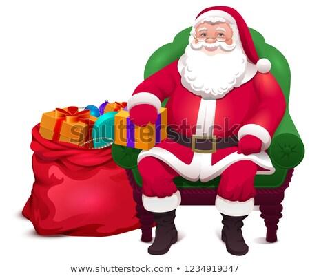 Papá noel sentarse silla dar bolsa regalos Foto stock © orensila