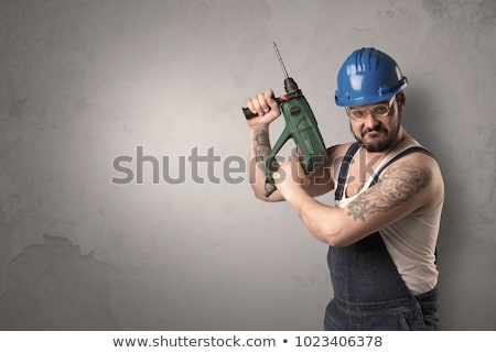 craftsman standing in front of an empty wall stock photo © ra2studio