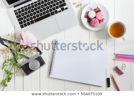 Woman or feminine workspace with notebook, macarons and flowers  Stock photo © Illia